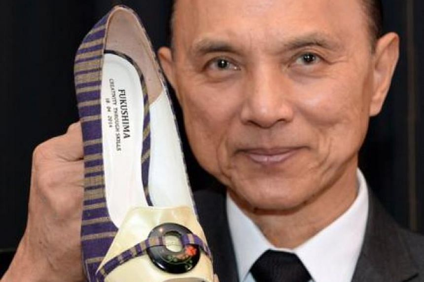 610ccd0bfb8e Designer Jimmy Choo poses with his one-off shoes made with materials from  Japan s Fukushima