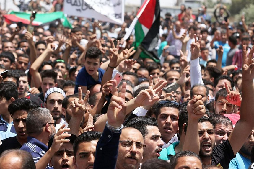 Mourners attend the funeral of 17-year-old Mohammed Jawawdeh, who was killed on the weekend when he attacked a security guard at the Israeli embassy compound in the Jordanian capital with a screwdriver, on July 25, 2017, in Amman.