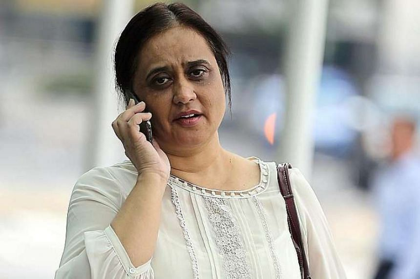 Parmjit Kaur, a former chief operating officer of bar and dining chain Harry's, arriving at the State Courts on June 20, 2016.