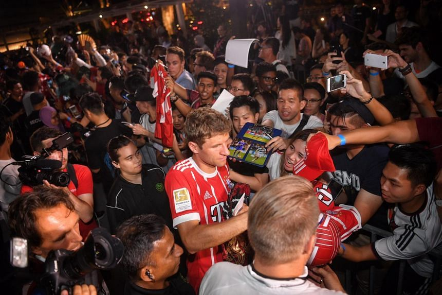 Thomas Muller signs autgraphs for Bayern Munich fans at Clifford Square during the Adidas Football Freestyle Battle on July 24, 2017.