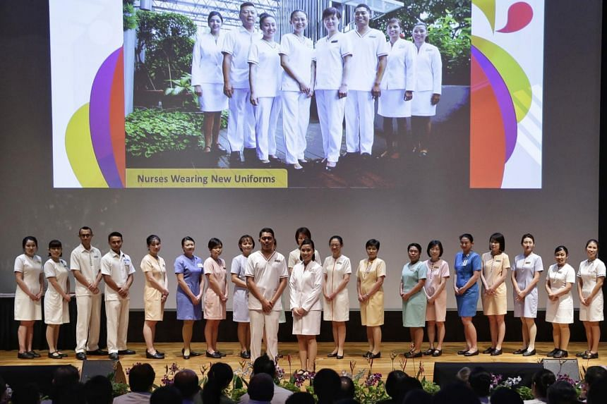 Nurses parading in new (front two nurses) and old uniforms (back row) at its annual Nurses' Day celebrations at Academia on July 25, 2017.