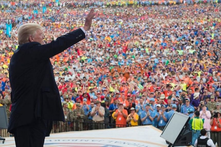 United States President Donald Trump waves after speaking to Boy Scouts during the National Boy Scout Jamboree in Glen Jean, West Virginia, on July 24, 2017.