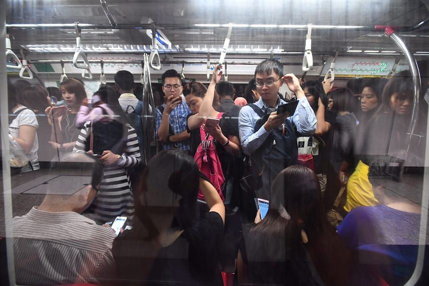 Passengers inside a train at Braddell station towards Raffles Place at around 8am on Tuesday (July 25).