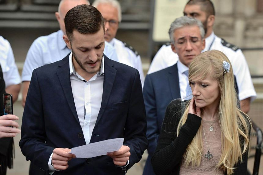 Chris Gard (left) and Connie Yates, the parents of terminally ill infant Charlie Gard, reading a statement in London on July 24, 2017.