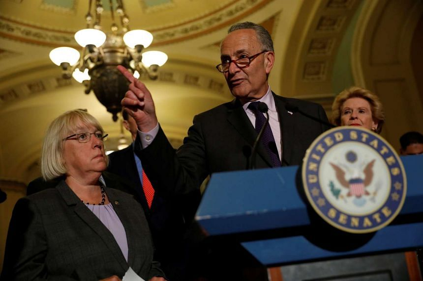 Senate Minority Leader Chuck Schumer speaks with reporters following the successful vote to open debate on a healthcare bill on Capitol Hill in Washington, DC, on July 25, 2017.