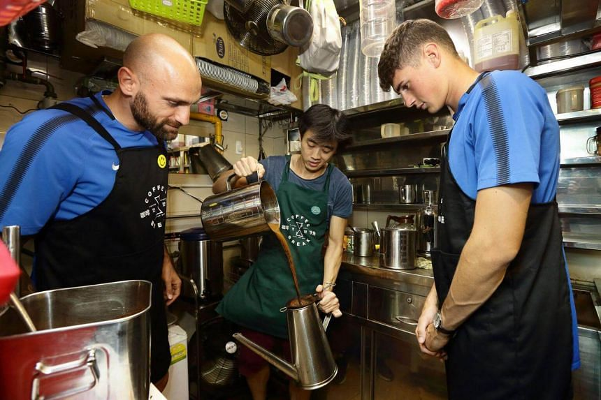 Inter players Tommaso Berni and Federico Valietti engaged in some some local coffee-making at Amoy Street Food Centre.