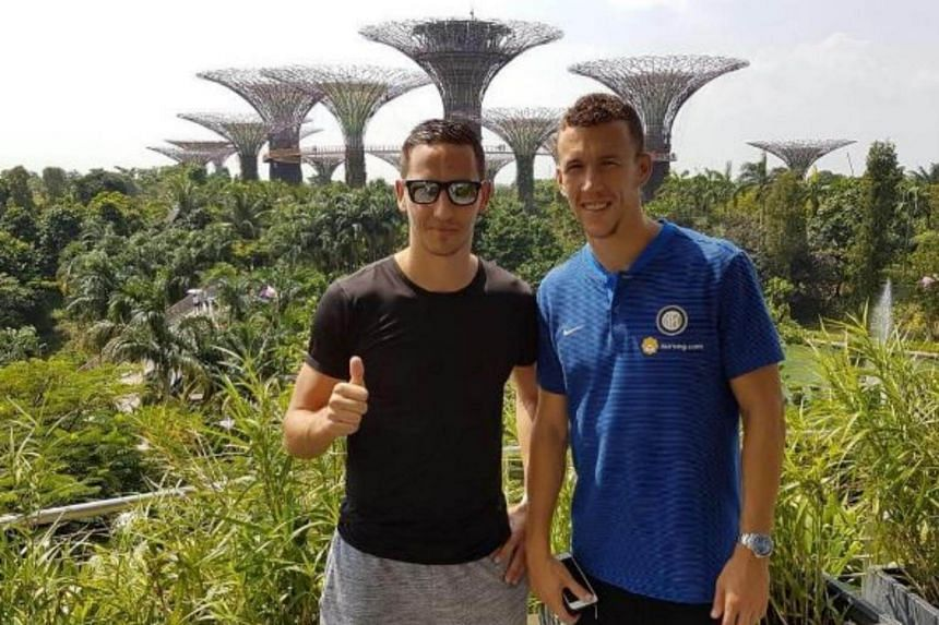 Inter's Ivan Perisic (right) reunited with Home United's Stipe Plazibat, his Hadjuk Split youth team-mate who now plays in the S-League.