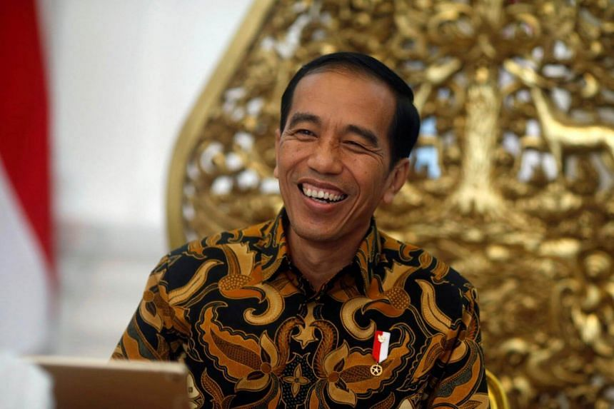 Indonesia's President Joko Widodo gestures during an interview with Reuters in Jakarta, on July 3, 2017.