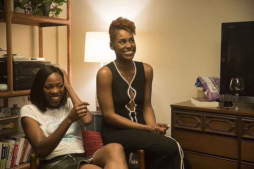 Issa Rae with co-star Yvonne Orji (far left) in Insecure.