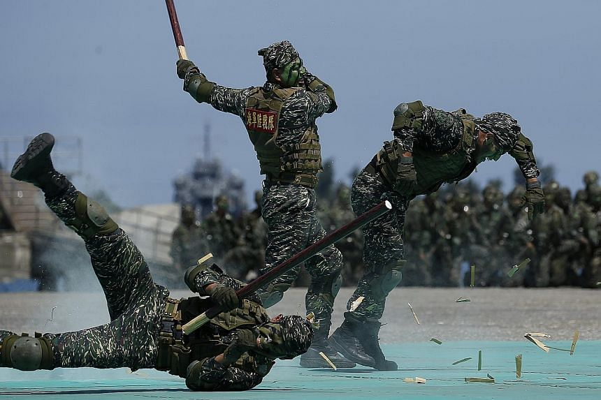 Taiwan navy personnel taking part in a mock attack during a naval exhibition drill in Kaohsiung city earlier this month. In response to recent incidents of Chinese warplanes flying near the island, Taiwan's Ministry of National Defence said that whil