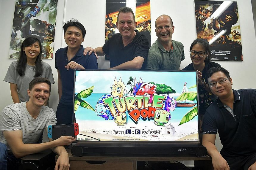 Zengami founder and chief executive Andrew Carter (centre) with co-founder Holger Liebnitz (on his left) and their team (from far left) Mr Raphael Haddad, Ms Crystal Toh, Mr Robin Choo, Ms Cindy Lee and Mr Matthew Yeung.