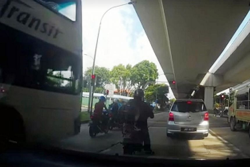 The aftermath of the accident in Pasir Panjang Road last Thursday morning. Two motorcyclists and a pillion rider aged between 23 and 39 were taken to hospital, and all three have been discharged. SBS Transit said it is assisting those injured and apo