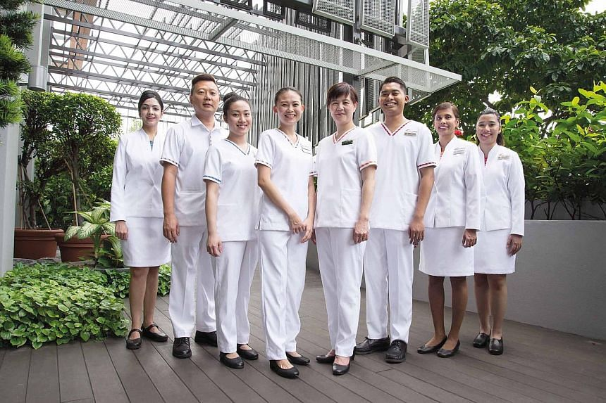SingHealth nurses modelling the new uniforms, which will be rolled out next year. As part of the change, a nurse's rank will be designated by different coloured strips, rather than uniforms in different hues.