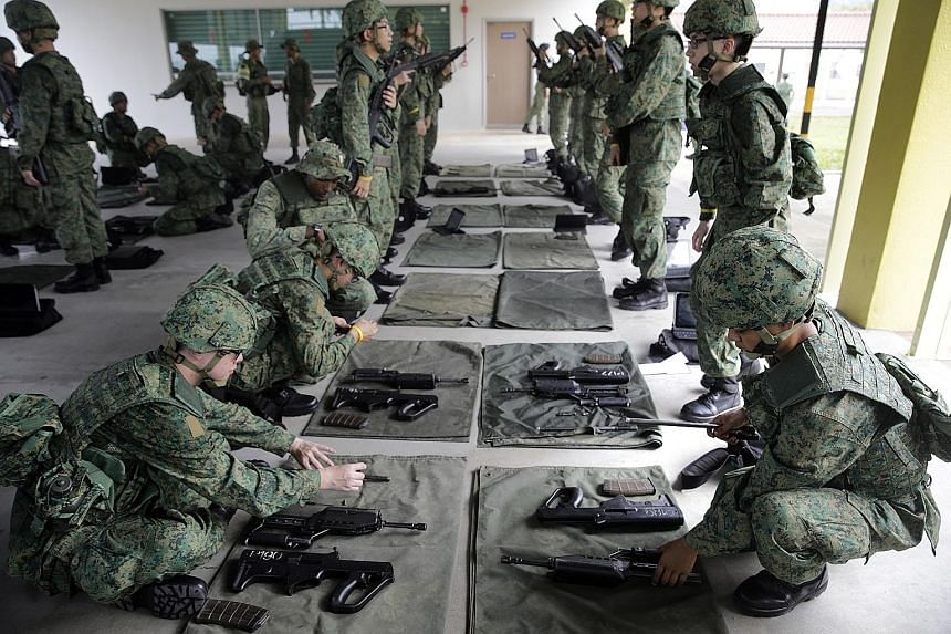 Recruits practising weapons handling at the Singapore Armed Forces Basic Military Training Centre in Pulau Tekong. The High Court set out written reasons for why NS dodgers who return to Singapore past the age of 40 should get sentences close to thre