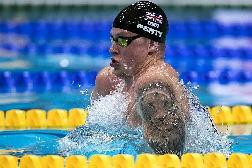 Britain's Adam Peaty clocking a new world record time of 26.10sec in the men's 50m breast heats at the World Championships. He broke it again, recording 25.95sec in the semi-finals.