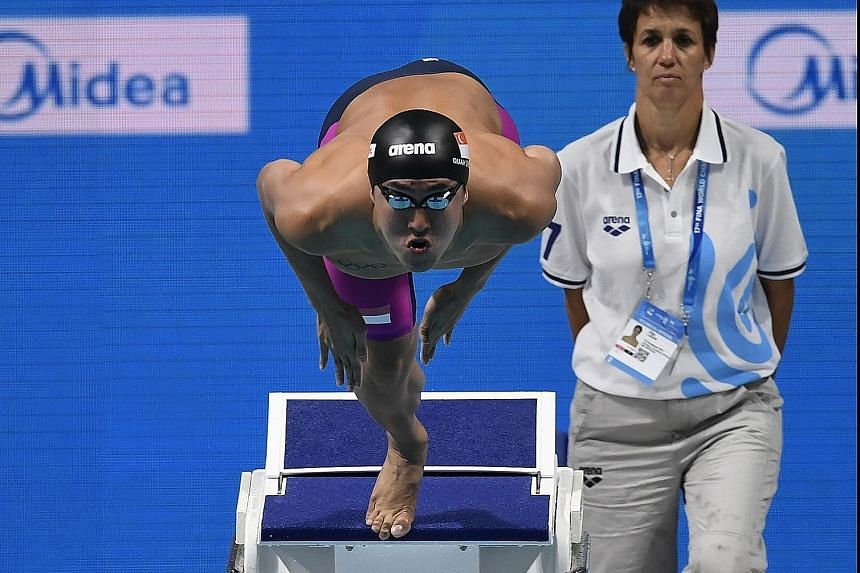 National swimmer Quah Zheng Wen finishing 18th overall in the 200m fly heats.