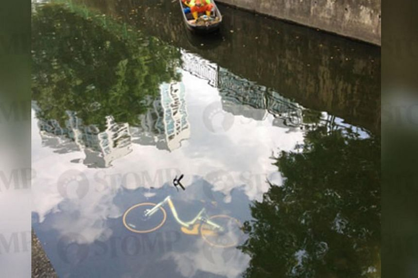The bike was spotted in the canal at Jalan Rajah at around 11am.