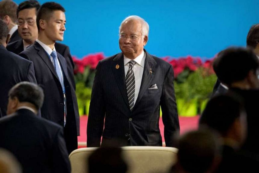 Malaysia's Prime Minister Najib Razak arrives for the opening ceremony of the Belt and Road Forum at the China National Convention Center in Beijing on May 14, 2017.