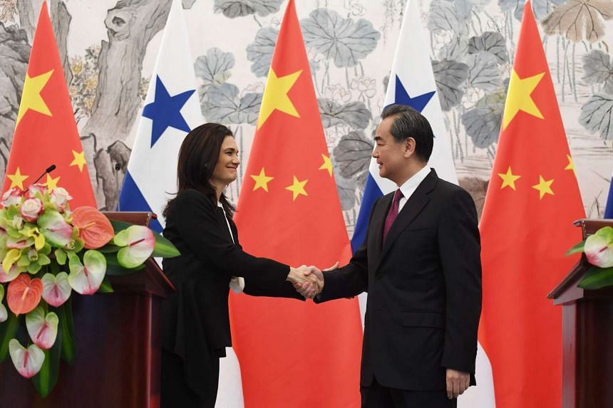 Panama's Vice President and Foreign Minister Isabel de Saint Malo (left) shakes hands with Chinese Foreign Minister Wang Yi after signing a joint communique, on June 13, 2017.