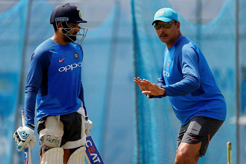 India's cricketer Rohit Sharma is advised by team's coach Ravi Shastri ahead of their first test match.