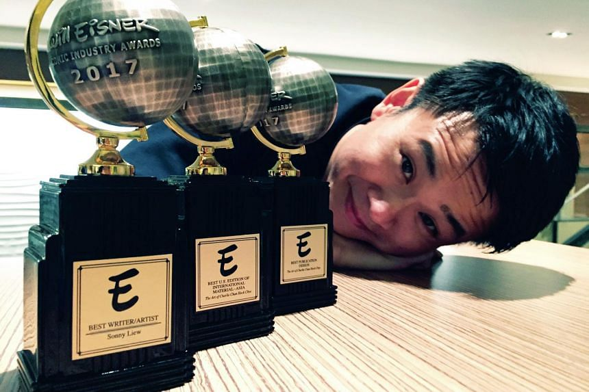Graphic novelist Sonny Liew with the three Eisner awards he won for his graphic novel, The Art Of Charlie Chan Hock Chye.