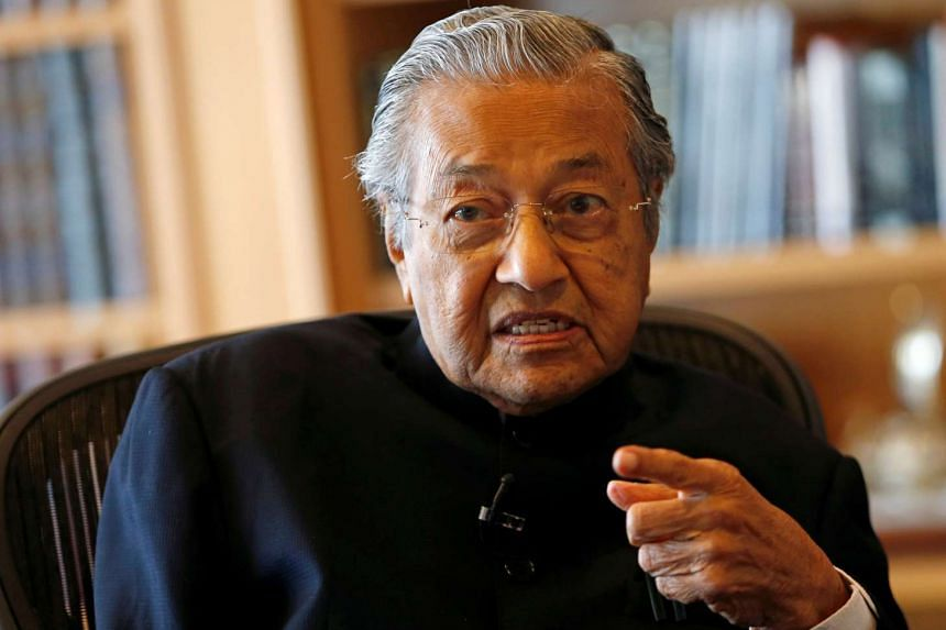 Former Malaysian prime minister Mahathir Mohamad speaks during an interview with Reuters in Putrajaya, Malaysia.