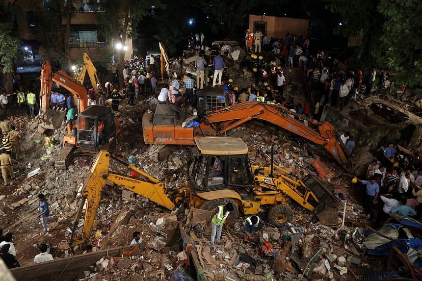 Resuce workers digging at the site of a four-storey residential building that collapsed in Mumbai, India, on July  25, 2017.