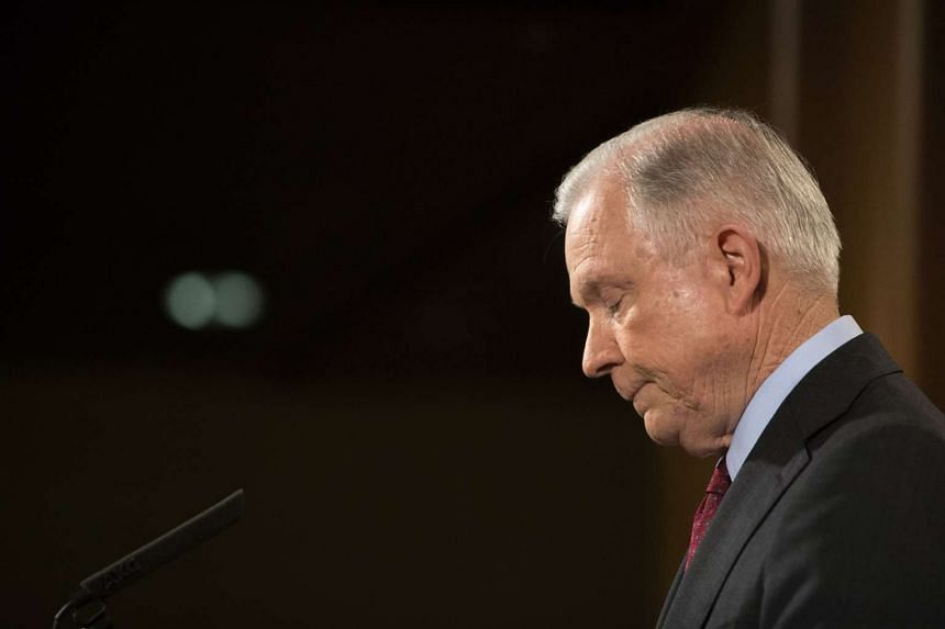 "Attorney General Jeff Sessions gives a statement stating that he will continue to serve ""as long as that is appropriate,"" following comments from President Donald Trump, at the Department of Justice in Washington, on July 20, 2017."