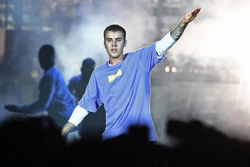 Pop star Justin Bieber, seen here performing in Paris in September last year, has cancelled his 15 remaining shows in North America and Asia.
