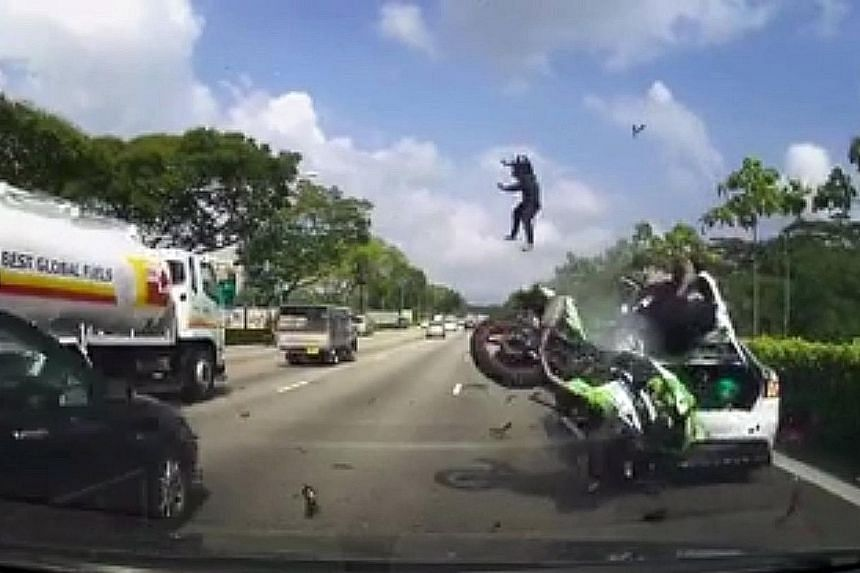 (Clockwise from top left) Screenshots from the video showing motorcyclist Danny Raj Muniappan, with pillion rider Trivikram R L, crashing into the stalled car on Seletar Expressway on Monday morning. The impact sends Mr Trivikram flying, before he la