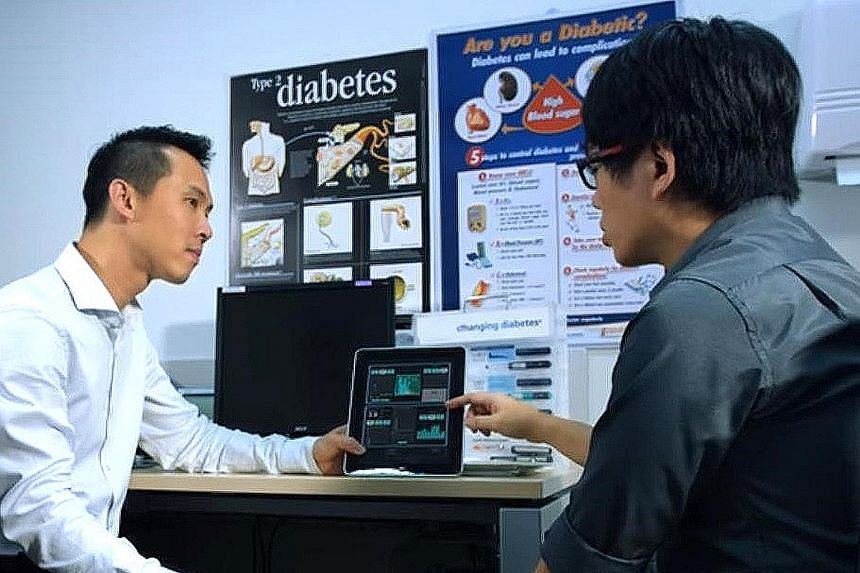Left: A diabetes patient having a consultation with NUH endocrinologist Yew Tong Wei (far left). Below: A sample of the results sent to diabetic patients before their consultations in Britain, under its National Health Service.