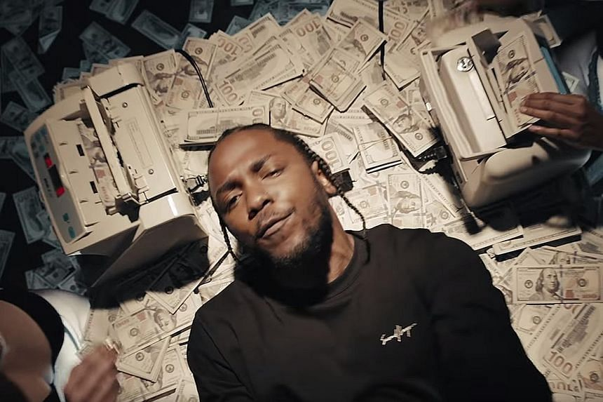The Humble music video shows Kendrick Lamar lying on piles of cash.