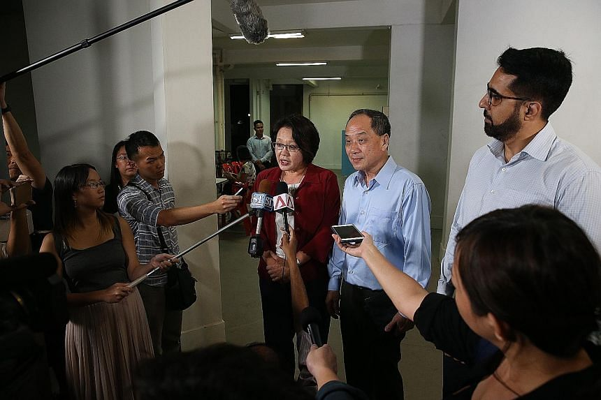 """Workers' Party MPs Sylvia Lim, Low Thia Khiang and Pritam Singh speaking to the media before Mr Low's Meet-the-People Session in Bedok Reservoir Road yesterday. In a statement earlier in the day, the WP MPs said they """"will contest the lawsuit and lay"""