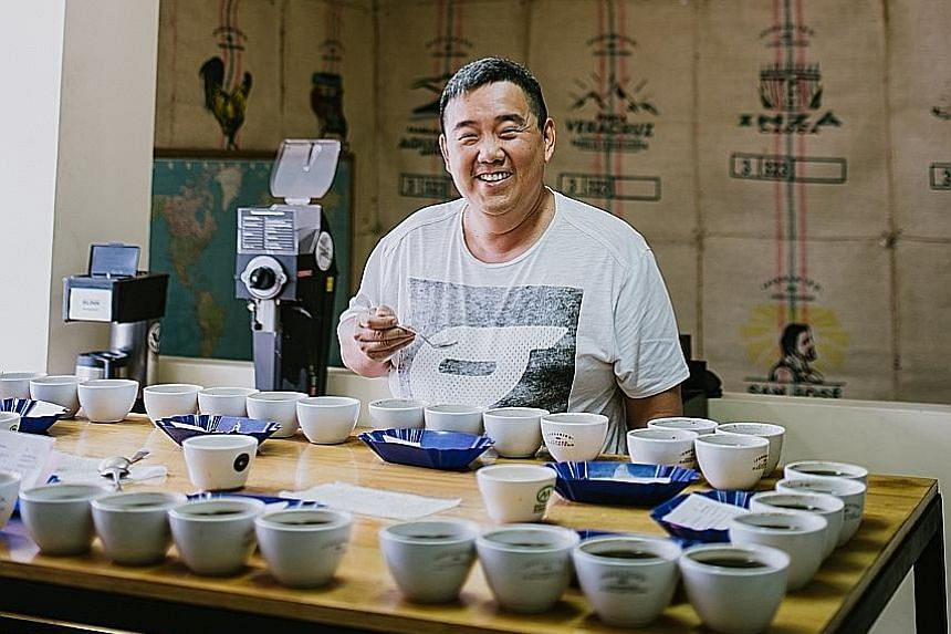 Jewel Coffee owner Adrian Khong at a coffee-tasting session on his trip to Colombia. Jewel Coffee will be showcasing its freshly roasted beans at this year's Singapore Coffee Festival, starting on Aug 3.
