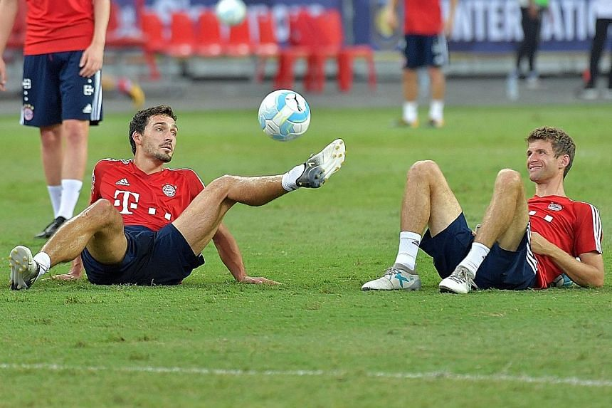 Bayern Munich stars Mats Hummels (left) and Thomas Muller training at the National Stadium ahead of today's clash against Inter Milan. Defender Hummels rates the Serie A outfit as a strong side.