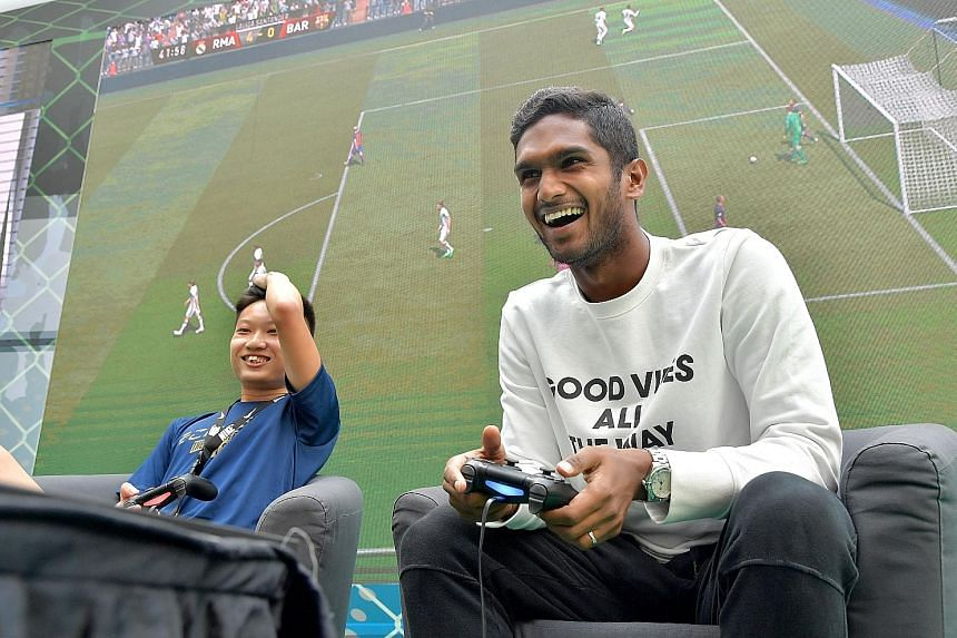 National football captain Hariss Harun enjoying himself in his 6-0 win over Damien Lim in a Fifa 17 game at Kallang Wave Mall. Currently on loan at Home United, he is still hopeful of working something out with his Malaysia Super League club Johor Da
