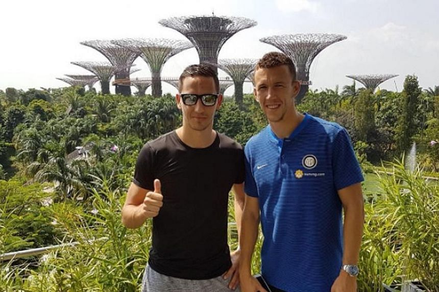 Home United's Stipe Plazibat (far left) and Inter Milan's Ivan Perisic hanging out at Gardens by the Bay. However, when they meet, they barely talk about football.