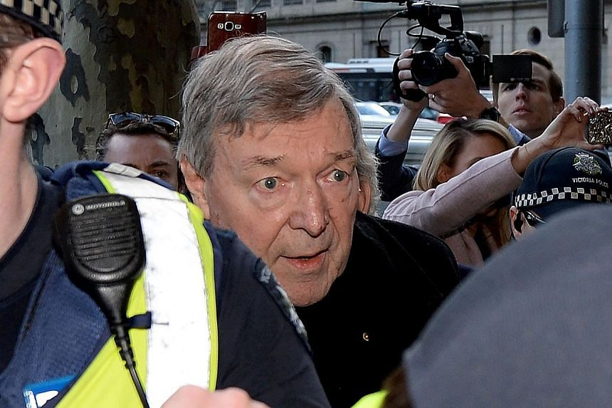 Cardinal George Pell arriving at Melbourne Magistrates' Court yesterday to answer charges of historical sexual abuse.