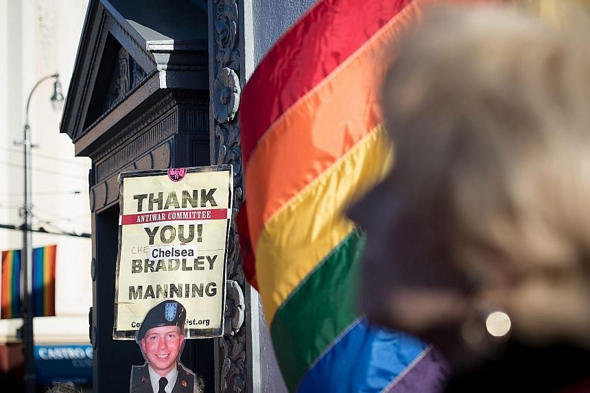 People holding up signs during a celebration in California for transgender soldier Chelsea Manning's release in May. Late last month, Defence Secretary Jim Mattis approved a six-month delay in allowing transgender recruits to join the United States m