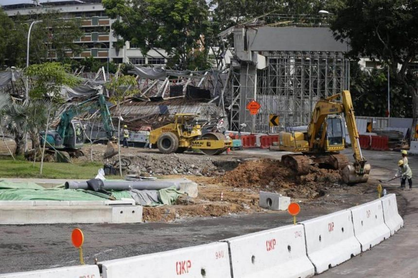 Excavation works on July 15, 2017, for a temporary bypass road for traffic heading towards PIE (Changi Airport) from Upper Changi Road East, after a section of a viaduct undergoing construction collapsed the day before.