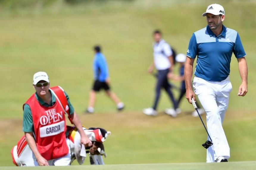 Spain's Sergio Garcia (right) walks onto the 9th green during his final round on day four of the 2017 Open Golf Championship at Royal Birkdale golf course near Southport in north west England on July 23, 2017.