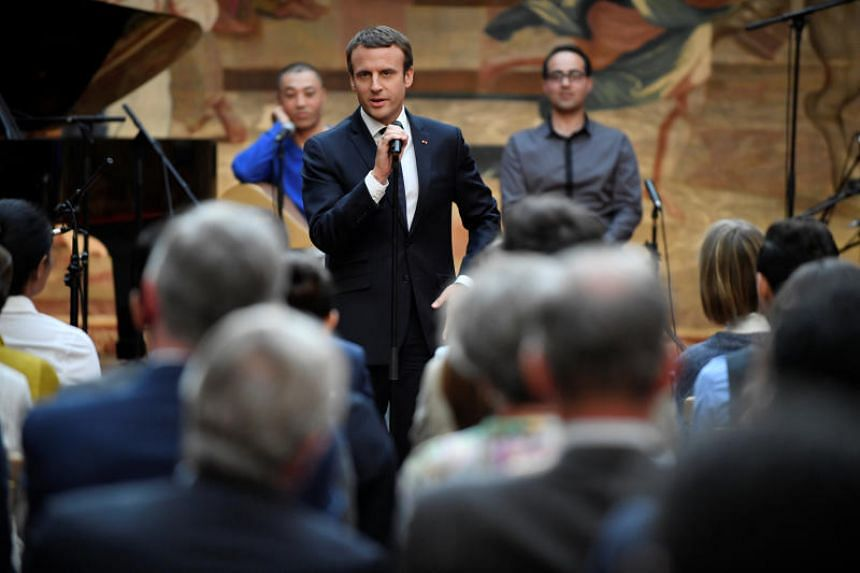 French President Emmanuel Macron speaks ahead of a concert given by the Pierre Claver Association at the Elysee Palace in Paris.