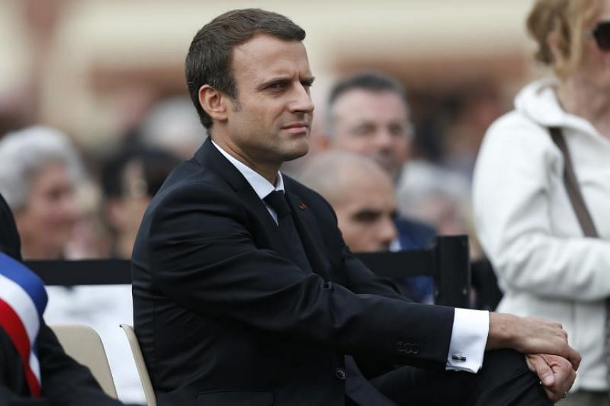 French President Emmanuel Macron listens to speeches in northern France on July 26, 2017.