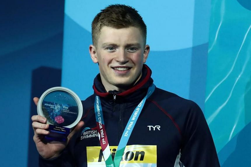 Great Britain's Adam Peaty celebrates winning the gold medal during the podium ceremony for the men's 50m breaststroke final at the 2017 FINA World Championships in Budapest, on July 26, 2017.