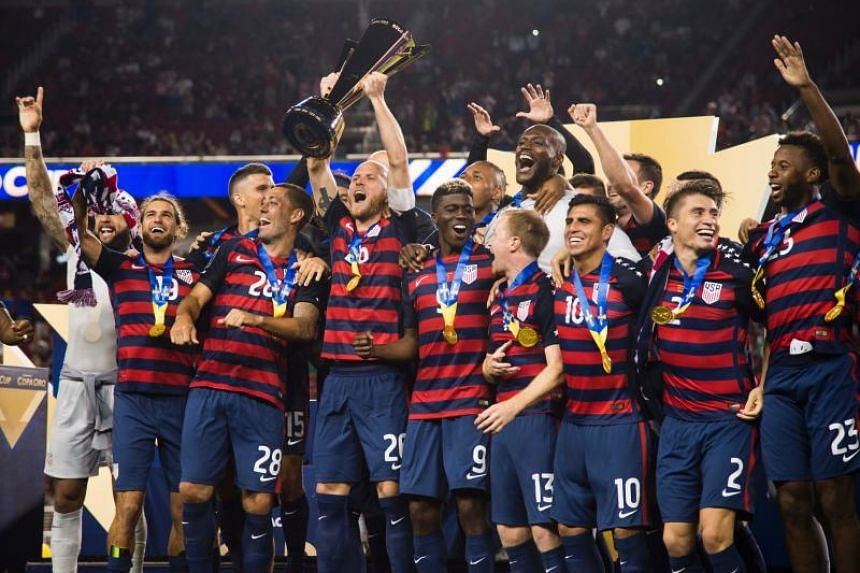 USA team captain Michael Bradley holds up the trophy as he celebrates with teammates after USA defeated Jamaica 2-1 in the 2017 CONCACAF Final.