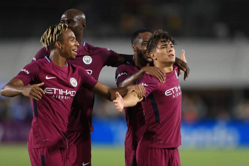 Brahim Diaz  of Manchester City celebrates after scoring a goal during the second half of the International Champions Cup football match between Real Madrid.