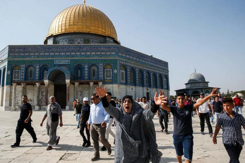 A Palestinian Muslim woman reacts upon entering the Haram al-Sharif compound, known to Jews as the Temple Mount, in the old city of Jerusalem on July 27, 2017, after Israel removed controversial security measures there.