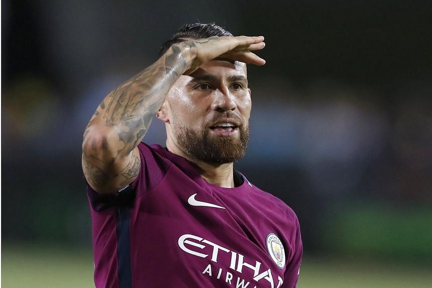 Manchester City Nicolas Otamendi gestures after scoring a goal against Real Madrid in second half action of their International Champions Cup soccer match at the Los Angeles Memorial Coliseum in Los Angeles, California, USA on July 26, 2017.