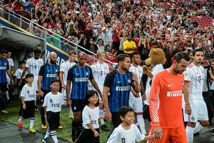 Players from Inter Milan and Bayern Munich walk out onto the pitch ahead of their ICC match at the National Stadium on July 27, 2017.