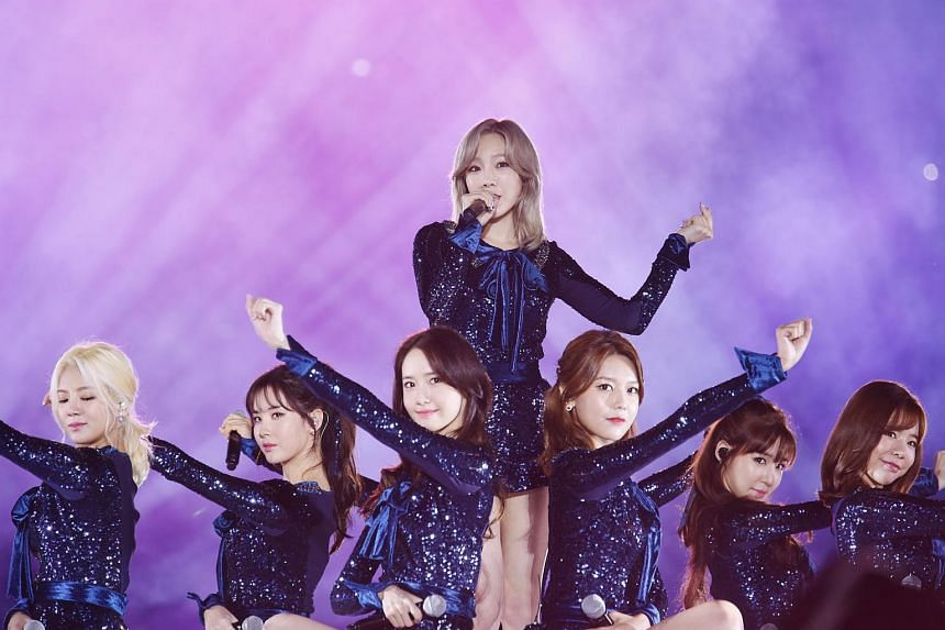 Girls' Generation's (from left) Hyoyeon, Seohyun, Yoona, Taeyeon, Sooyoung, Tiffany and Sunny performing at the opening concert of the inaugural Busan One Asia Festival held at the Busan Asiad Main Stadium on Oct 1, 2016.